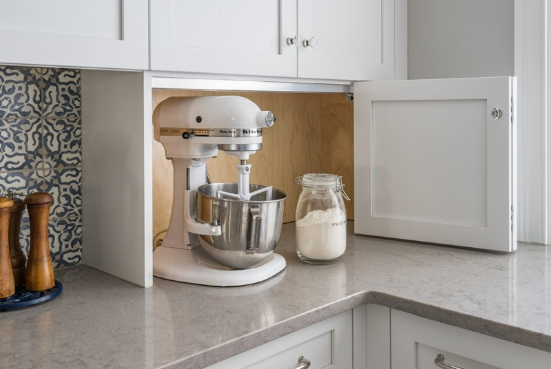 <strong>Don't want cluttered countertops? Hide small appliances behind a bi-fold cabinet.</strong><br> Photo credit: Eric Roth Interior Design: Amy McFadden Design