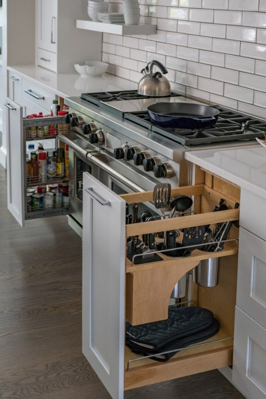 <strong>From spatulas to spices, storing items in tricked-out pullout cabinets like these keep a busy kitchen organized.</strong><br>Photo credit: Eric Roth