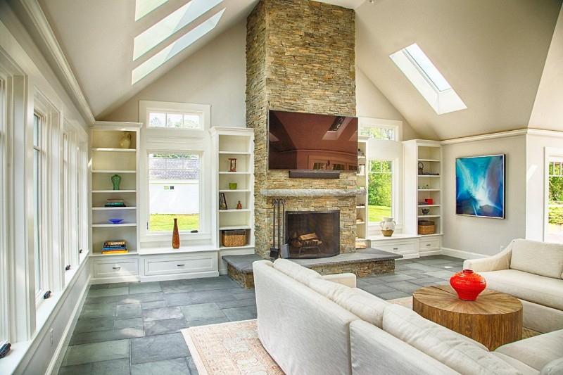 Newbury home\'s 1,200-square-foot addition featured cathedral ceiling and fireplace with 14 skylights, and bluestone radiant heat floors.