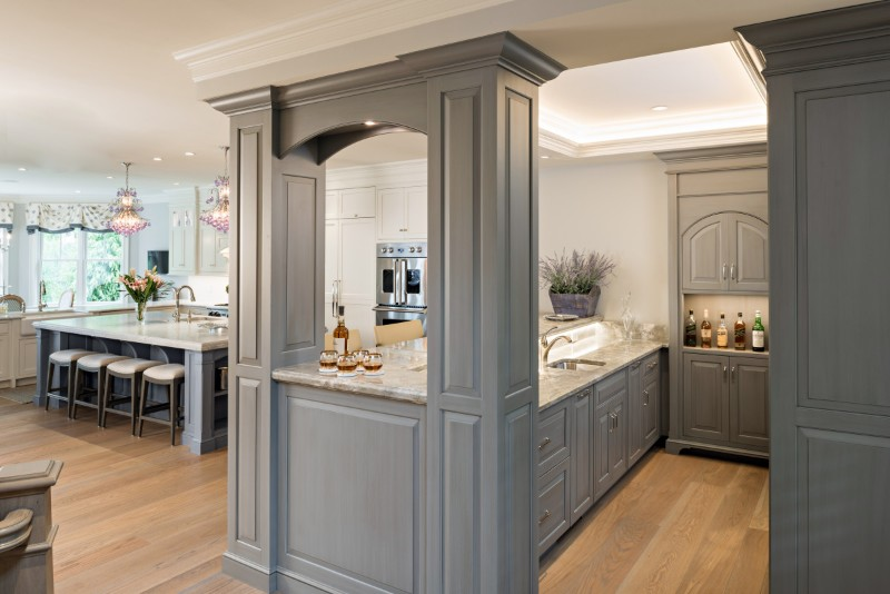 <strong>The gray tones of the bar are a perfect complement to the periwinkle blue of the kitchen island, creating an open entertaining space uniquely personal to the client and their guests</strong><br>Dan Cutrona