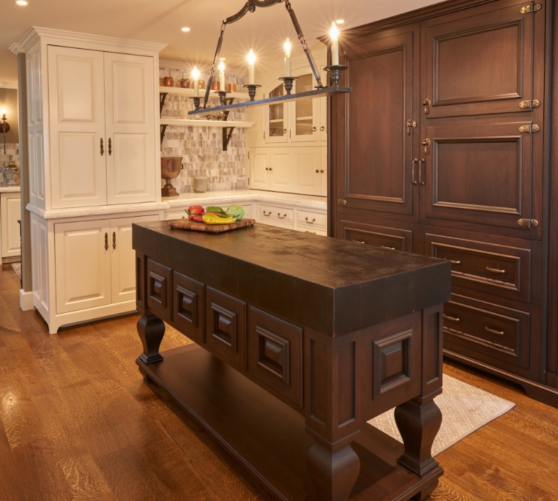 """<strong>Customized walnut paneling on dual 36"""" refrigerators with doors overlaid on panels to replicate an old-fashioned ice box</strong>"""