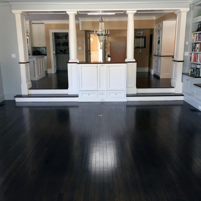<strong>Dark Floors</strong><br>These quarter-sawn white oak floors were installed, refinished, and then dye and stain were applied to create the deep dark color.