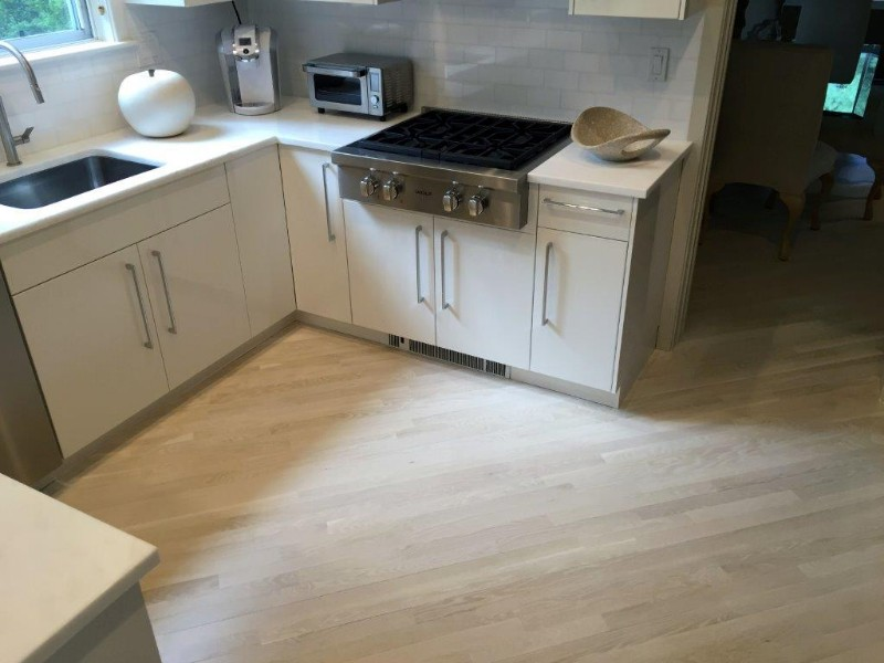 <strong>White Stain</strong><br>These white oak kitchen floors were refinished with a coating of white stain.