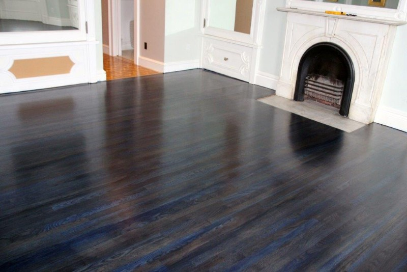 <strong>Midnight Blue Floors</strong><br>These white oak floors were installed and refinished before a coating of midnight blue stain was applied.