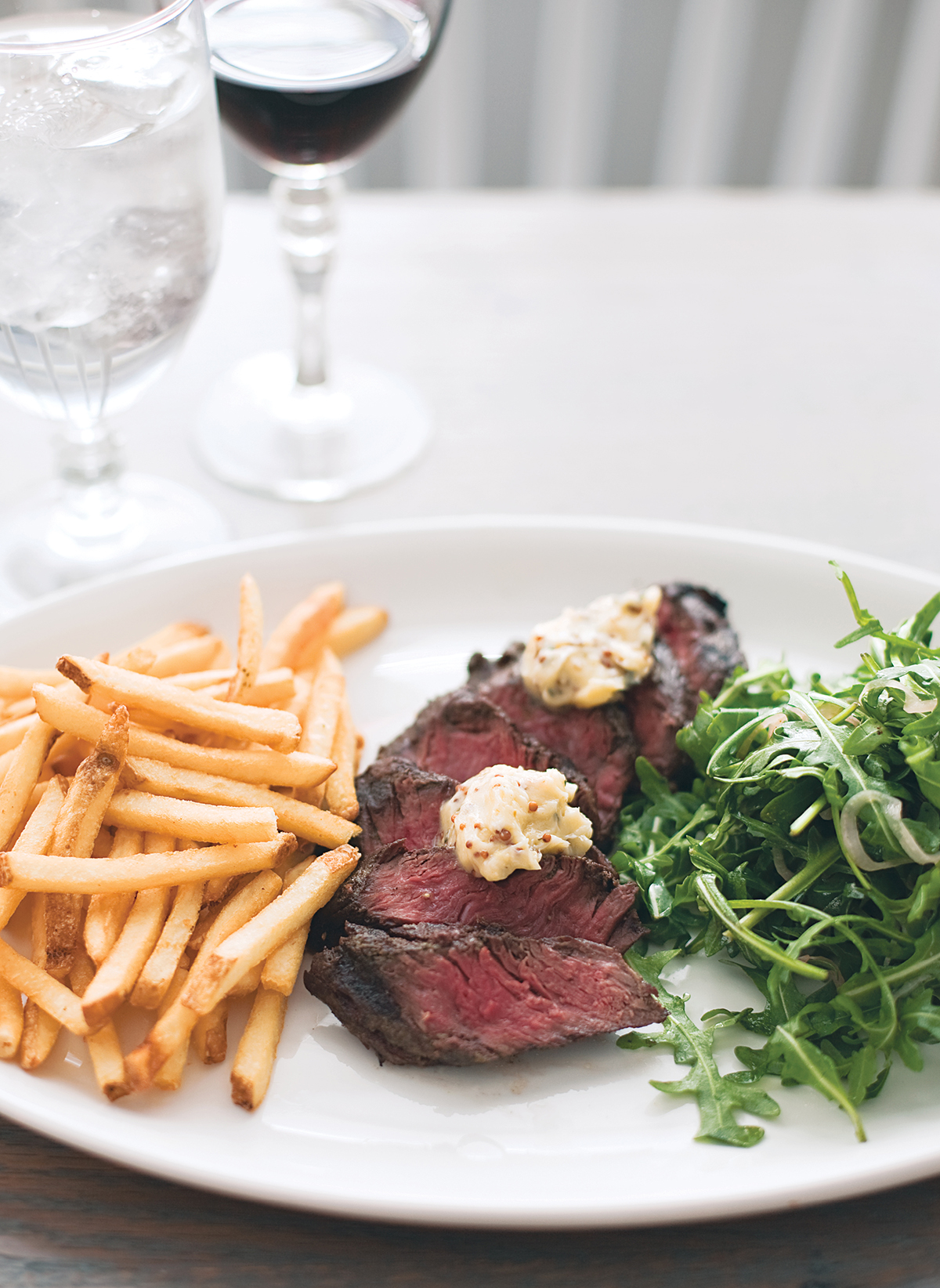 steak frites at woodward in the ames hotel. Photograph by Keller + Keller.