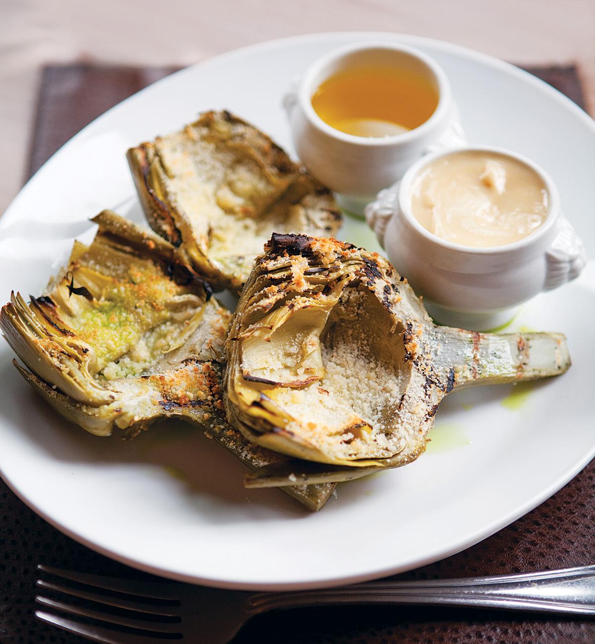 Jumbo grilled artichokes with roasted garlic aioli, $12. Photograph by Keller + Keller.
