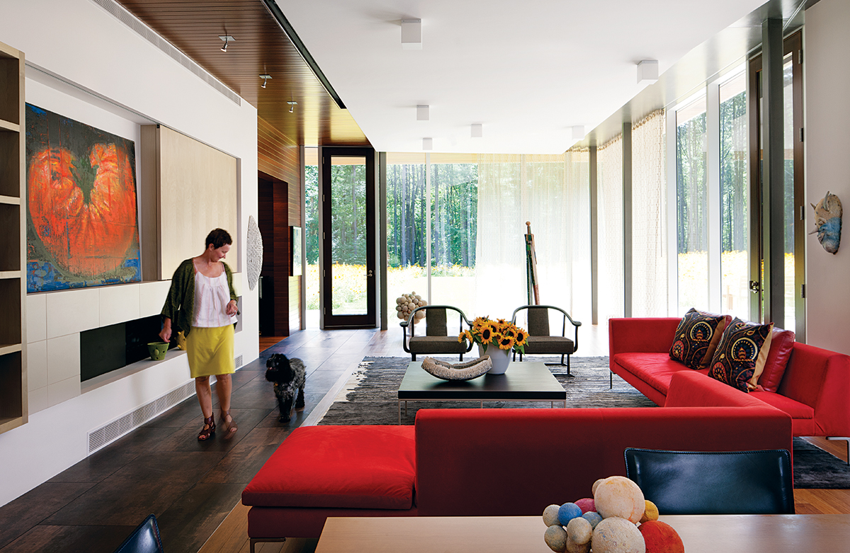 Meadow Views: Deborah Hawkins and her English cocker spaniel, Cooper, stroll through the living room, outfitted with B & B Italia sofas from Montage. Photograph by Greg Premru
