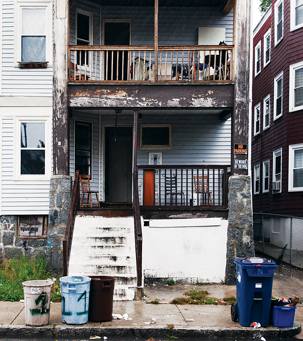 Landlords who own houses like 30 Ridgewood Street in Dorchester have drawn the city's ire.                         Photograph by Scott M. Lacey
