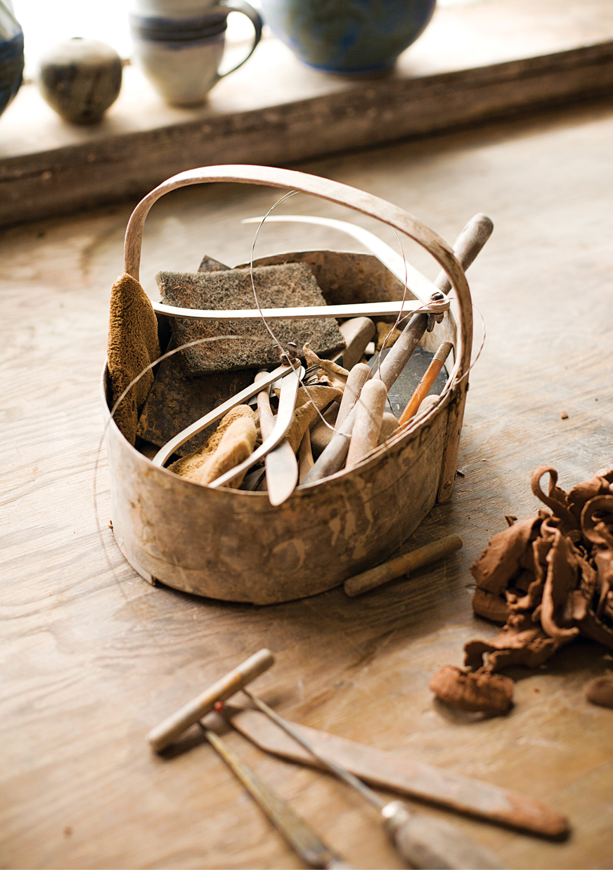 Potters' tools include knives, cutting wire, and calipers.