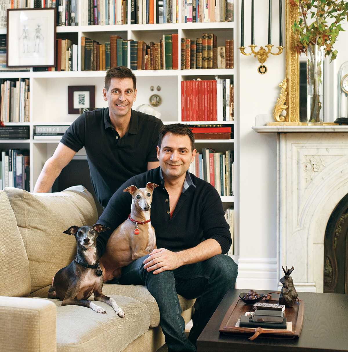 Brad Walker, left, and Rodin Shaw Cole share the sofa with their Italian greyhounds.
