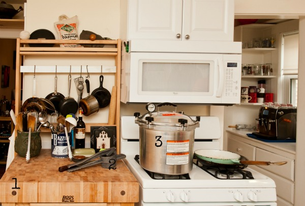 A Custom Butcher Block Table Next To The Stove Provides Essential Counter  Space. 2. The Couple Has A Bit Of An Obsession With Old School Potato  Ricers, ...
