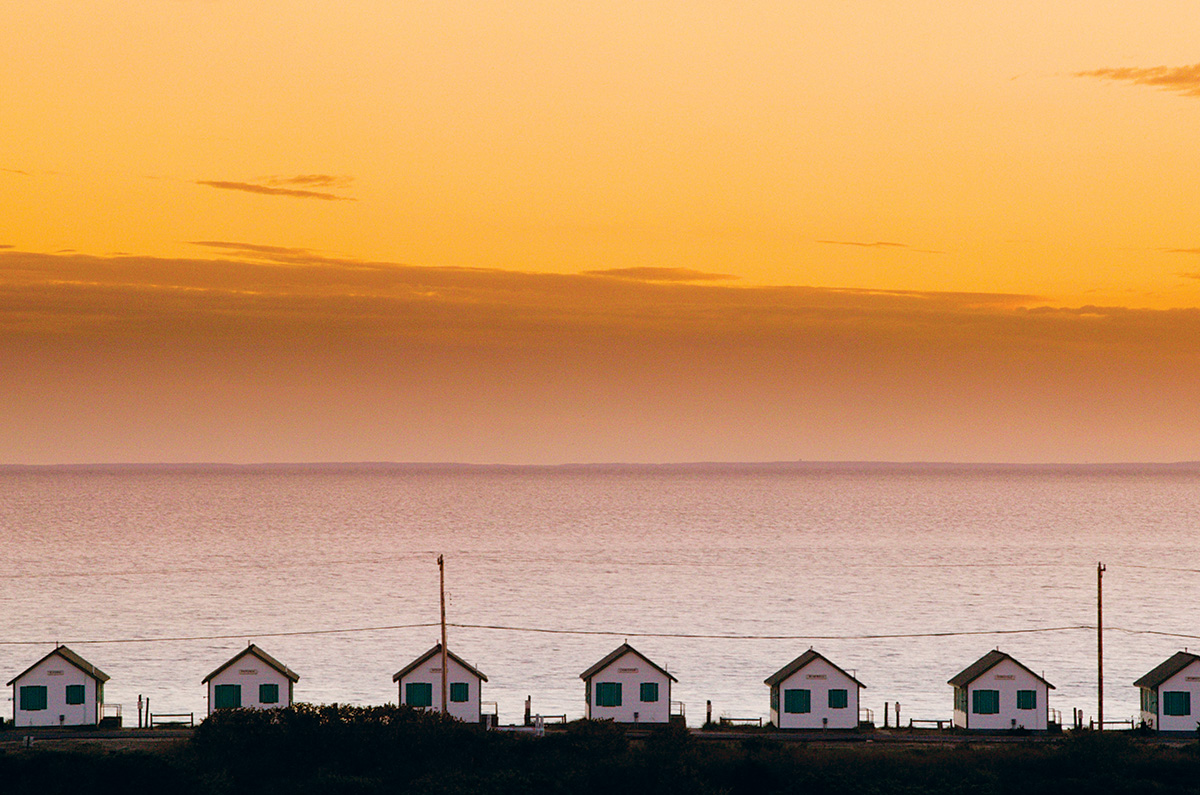 Cottages dotting Truro's coastline (image by Getty Images).