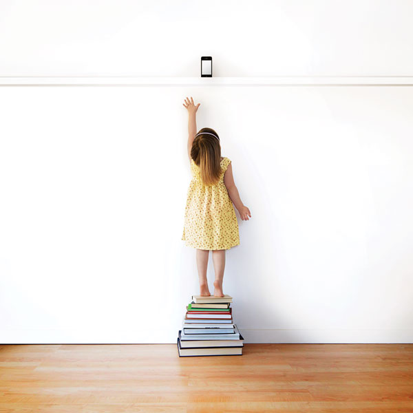 girl standing on books