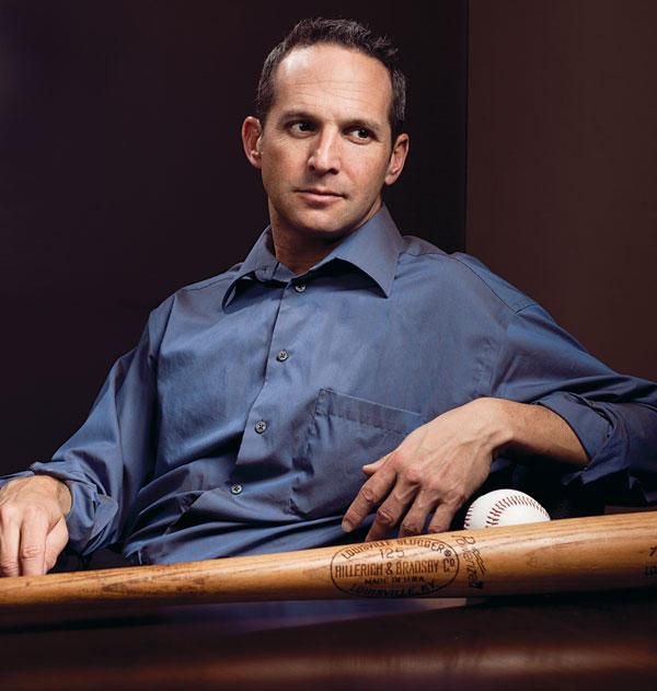 man sitting with baseball bat