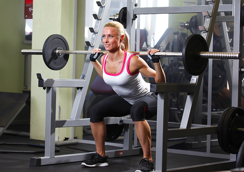 It looks harder than it is. Woman weightlifting photo via Shutterstock.