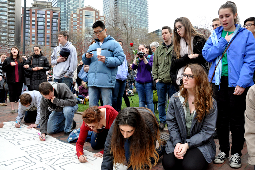 Mourners sign a banner on Boston Common. Photo by Regina Mogilevskaya