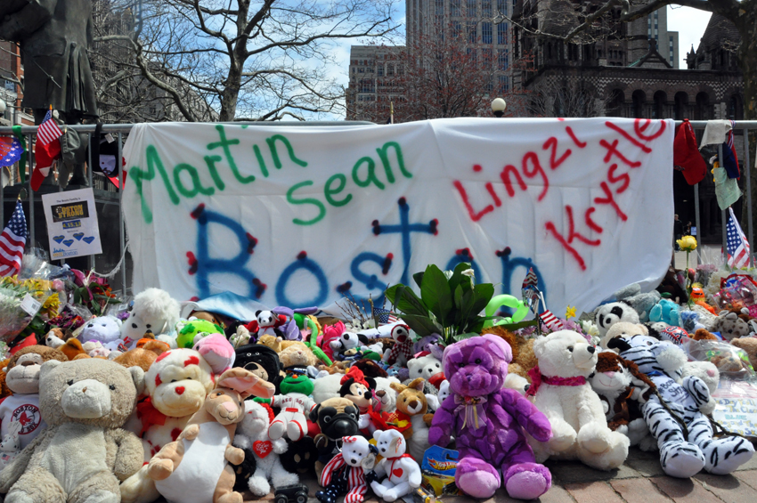 Stuffed animals lined up to honor and remember victims. Photo by Regina Mogilevskaya