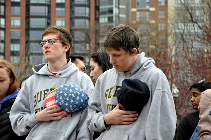 mourners in Suffolk university sweatshirts pay tribute to victims of Monday's tragedy. Photo by Regina Mogilevskaya
