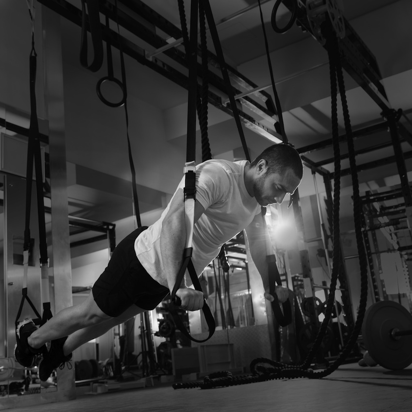 Working out at a CrossFit box photo via Shutterstock
