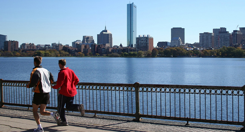 Joggers along the Charles. Photo via Shutterstock.