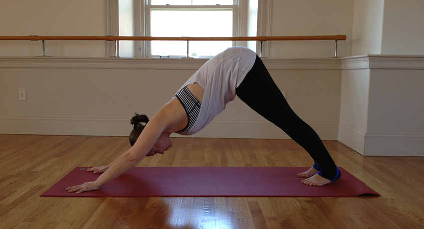 Stacey Allaire in downward dog. Photo provided