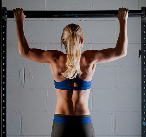 Whitney doing a pull-up. Photo by EAS Photography.
