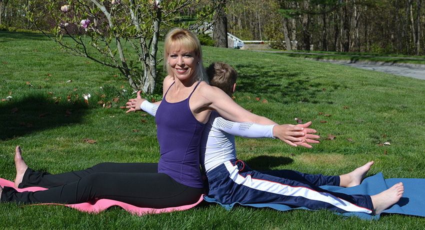 Julie and her son doing a Spine Twist. (Photo provided.)
