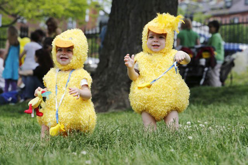 Two twins run dressed like ducks at last year's Duckling Day Parade (Photo via Friends of the Public Garden/Facebook).
