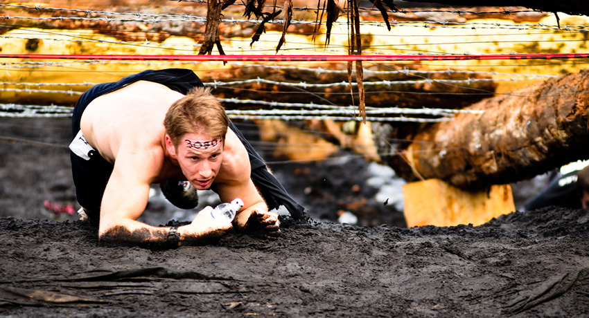 If mud and barbed wire is your thing, then this race round-up is for you. Photo via Flickr/Couloir