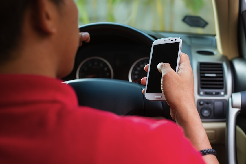 texting while driving photo via shutterstock.com