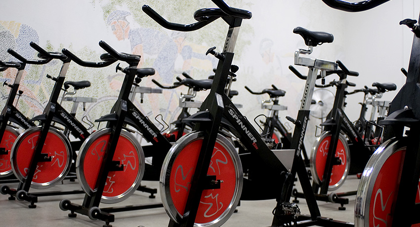 Indoor cycling bikes photo via Ron Kloberdanz / Shutterstock.com