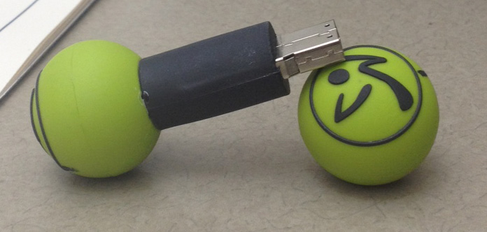 A Zumba flash drive on my desk.