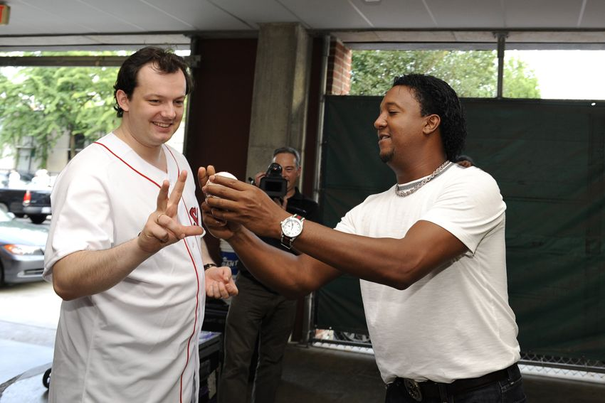Pedro Martinez gives Andris Nelsons a lesson before he throws out the first pitch at Fenway Park. (Photo by Stu Rosner)