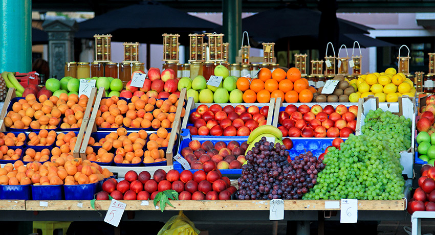 That's one way to get kids to eat fruits and vegetables. Give them no other choice. Fruit stand photo via Shutterstock.
