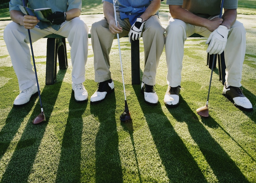 Male golfers over the age of 50 are at risk for melanoma. Golfers bench image via Shutterstock.
