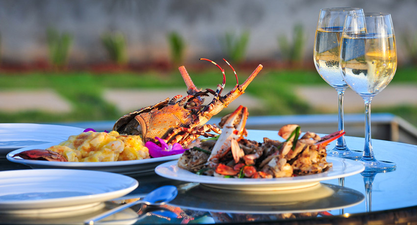 Summer alfresco dining and lobster go perfectly together. Lobster dinner photo via shutterstock.
