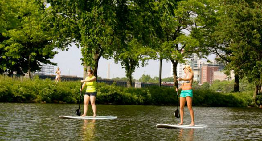 Paddleboarding on the Charles. Photo via By Land and Sea stand Up Paddle Facebook