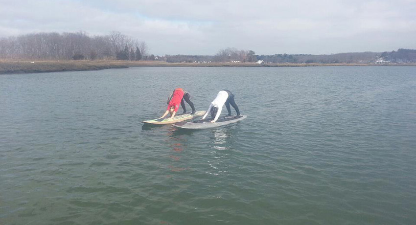 Paddleboard yoga photo via Cape Ann SUP Facebook.