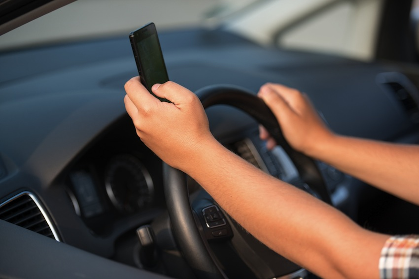 Texting photo via Shutterstock.com