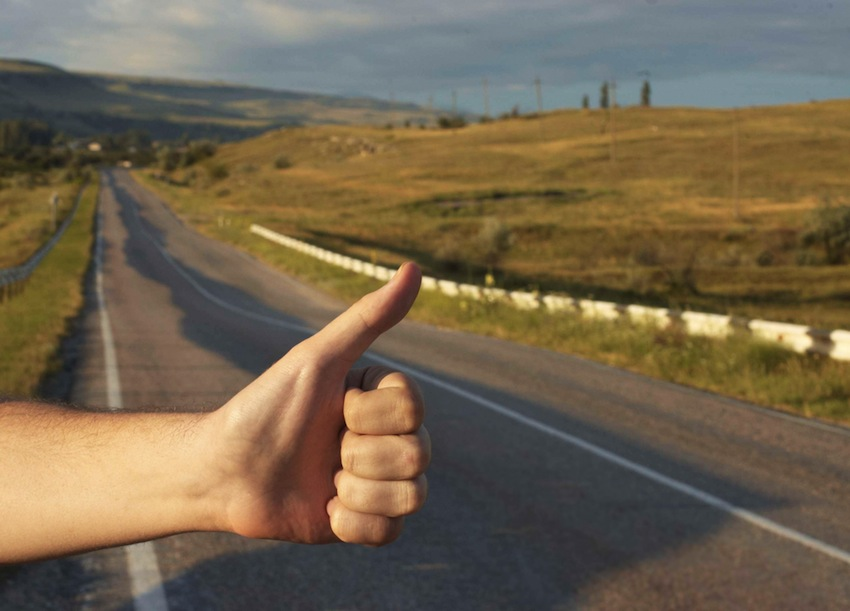 Hitchhiking photo via Shutterstock.com