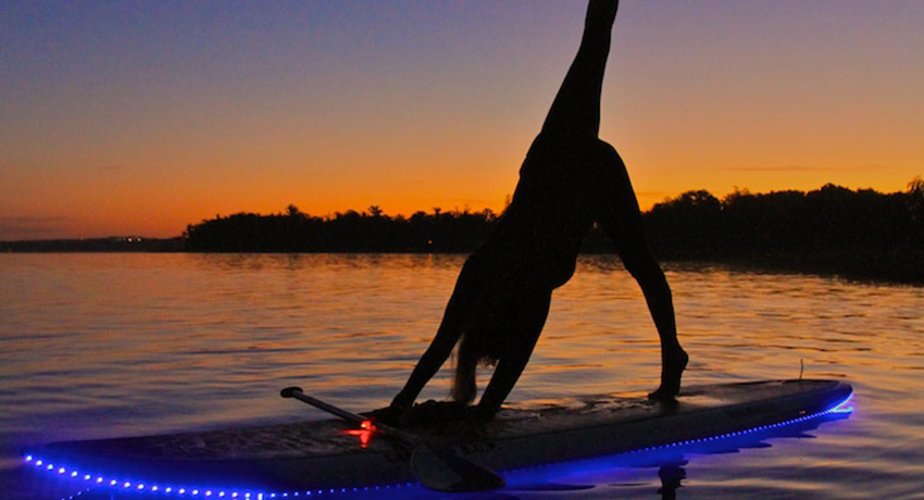 Sunset SUP yoga photo via Cape Ann SUP facebook.