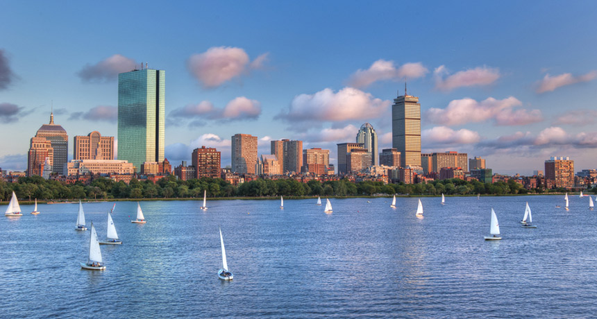 Charles River and Boston Skyline photo via Shutterstock.