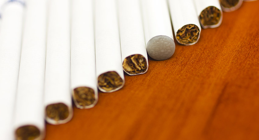 One of these things is not like the others. Cigarettes image via Shutterstock.