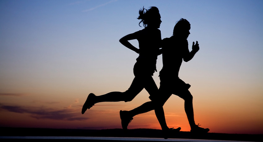 Looking for someone to go on sunset runs with? Running couple photo via Shutterstock.