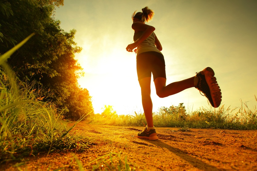Running without a device can help you focus on the present moment, rather than thinking about stressors. Sunset run image via Shutterstock.
