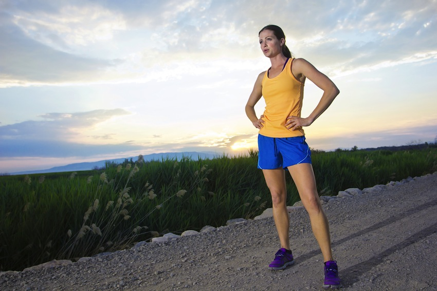 Stopping to catch your breath can be the best cure for side cramps. Runner image via Shutterstock.