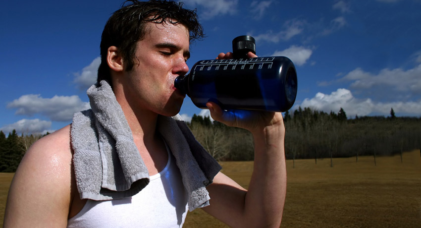 Hydration is key. Post-outdoor workout photo via shutterstock