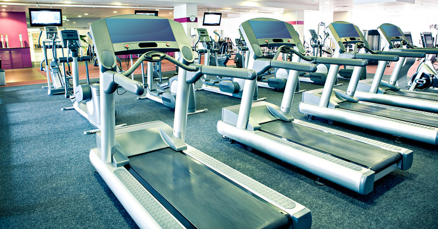 Those treadmills can be intimidating after a long holiday weekend. Gym photo via shutterstock.