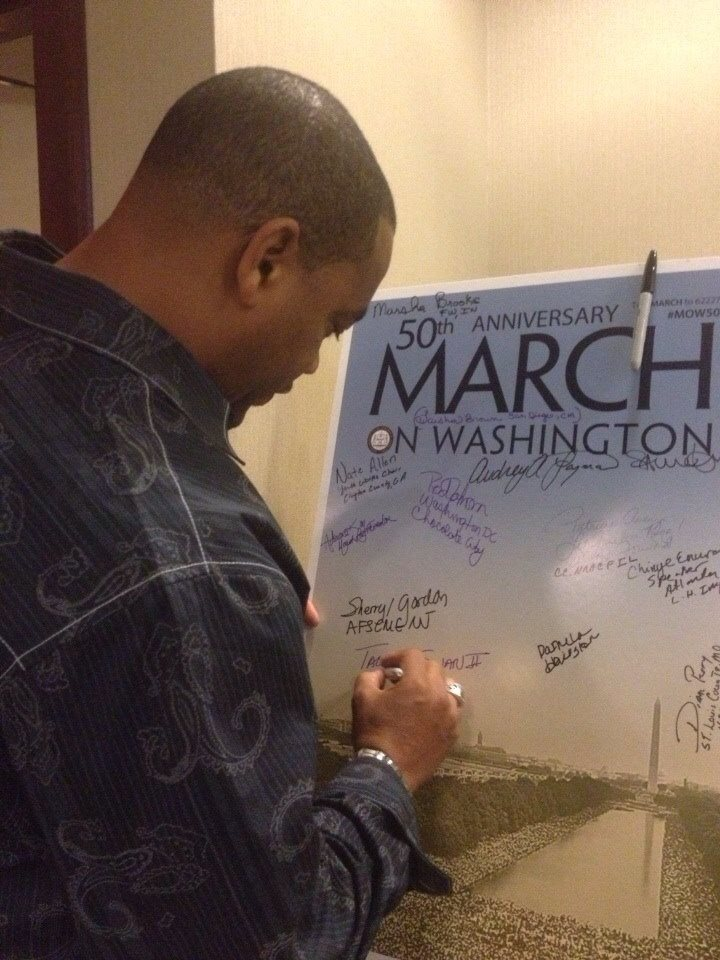 Rev. Talbert Swan signing a March on Washington plaque / Photo courtesy of Swan