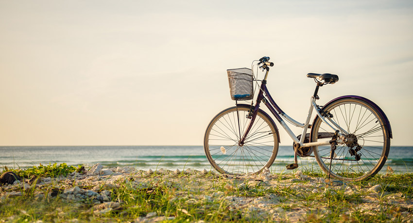 Bike at the beach photo via shutterstock